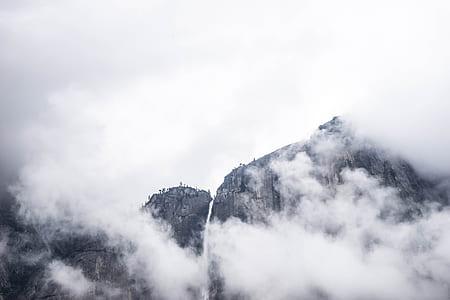grayscale photography of smoking volcano