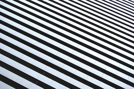 white and black stripe textile