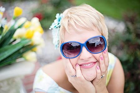 photo of a woman wearing purple wayfarer eyeglasses with blue frame