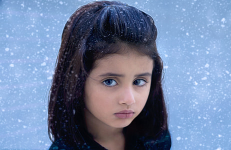 girl outside during snow storm photography