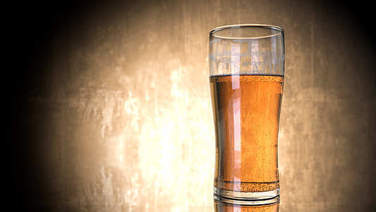clear highball glass filled by brown liquid photograph