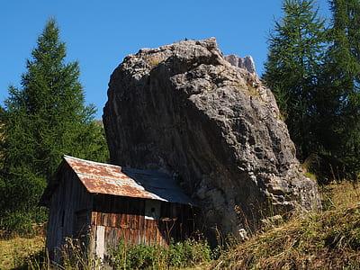 shed beside rock boulder