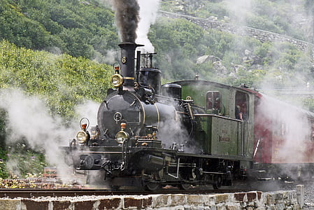 black, green, and red steam train