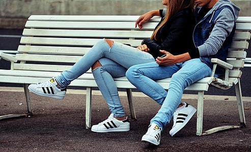 couple wearing blue jeans
