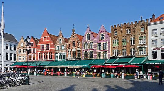 market near colorful establishment under blue sky