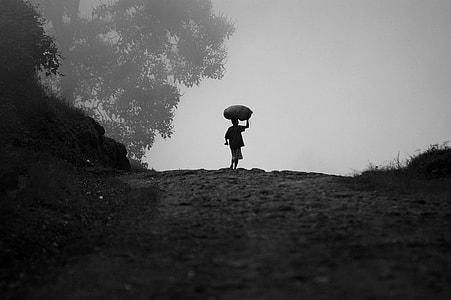 boy holding sack walking