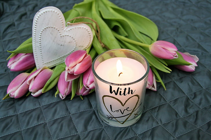 white candle with pink flowers