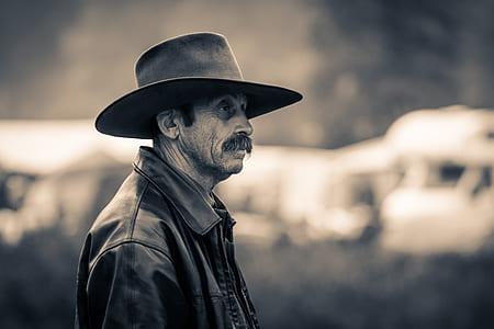 greyscale photo of cowboy