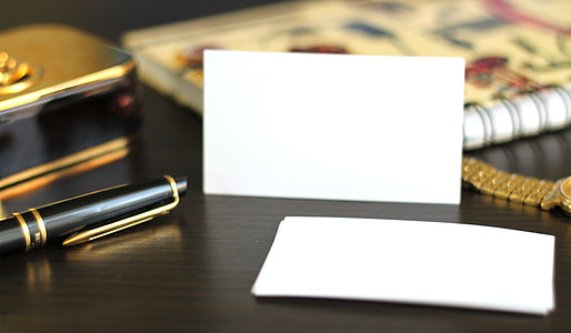 empty white sticky note on table beside click pen