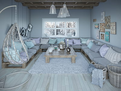 gray corner sofa with throw pillow and coffee table inside the living room