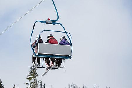 Three Skiers on Ski Lift