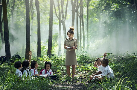 woman and children in forest during daytime