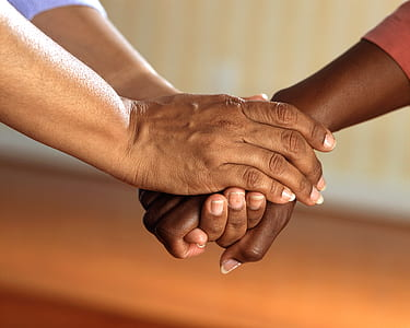 person holding person's right hand