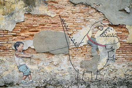 boy pulling dinosaur with leash mural painting