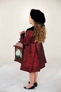 girl wearing red coat