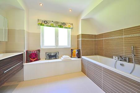 white and brown bathtub