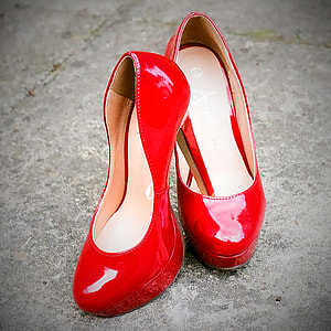 photo of pair of red patent leather platform heeled shoes