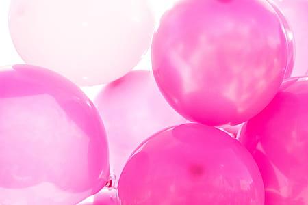 closeup photo of pink balloons