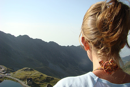 woman looking at mountain landscape during daytime