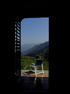 Blue and White Empty Armchair during Daytime Outside With Mountain Range Under Blue Sky during Daytime