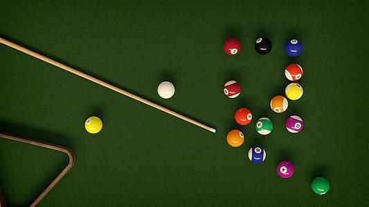 photograph of billiard balls, pile, and cue stick