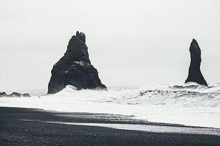 greyscale photo on seashore