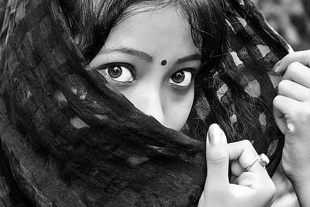woman face holding black textile
