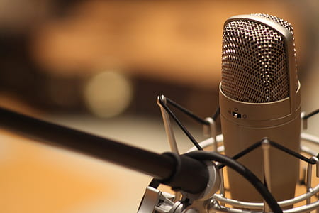 selective focus photography of silver condenser microphone