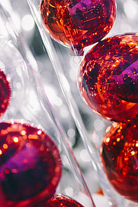Red Christmas baubles packed in plastic tubes