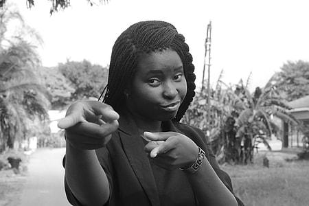women in black blazer pointing finger
