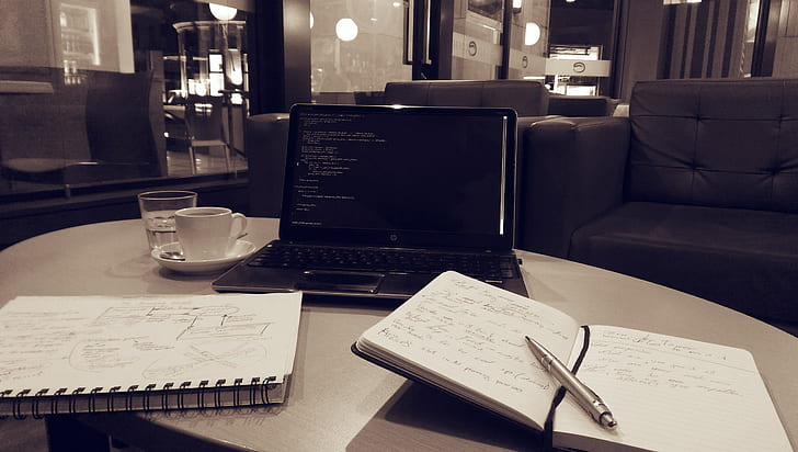 click pen and notebook in