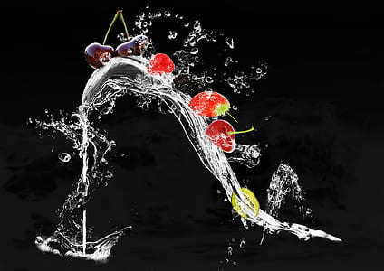 water drops with strawberry and cherry photo