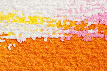 orange, white, and pink textile