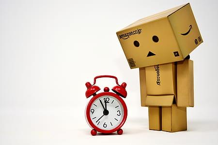 Amazon box looking at alarm clock illustration