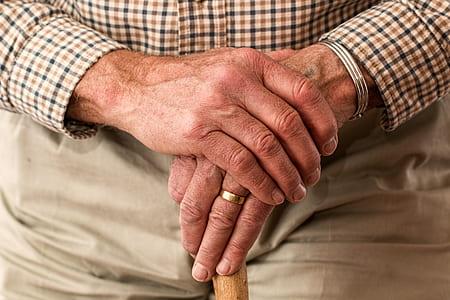 elderly man wearing dress shirt and wedding band ring