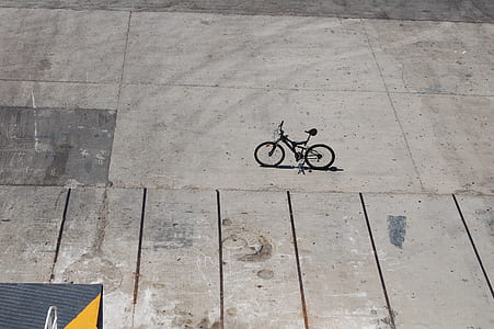 black full-suspension bike on concrete ground