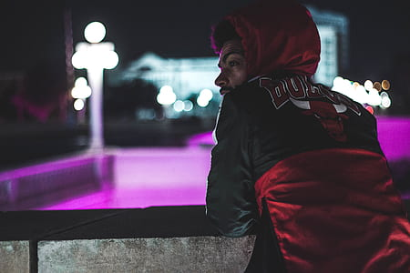 man in black and red hoodie
