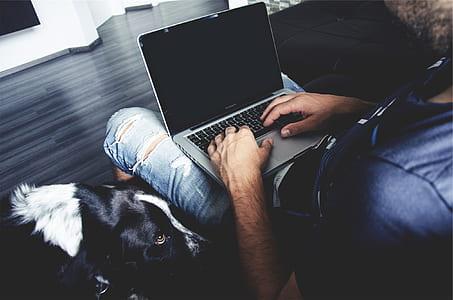 MacBook Pro on man lap