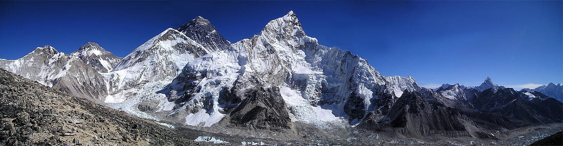 Mountain Filled With Snow Under Blue Sky during Daytime
