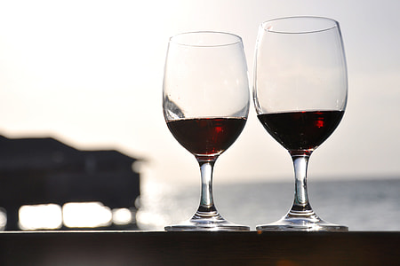 focus photography of long-stemmed wine glasses