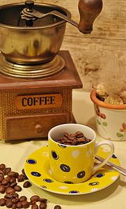 white and yellow ceramic mug with saucer