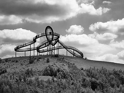 gray roller coaster grayscale photo