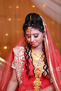 Woman in Red and White Sari Traditional Dress
