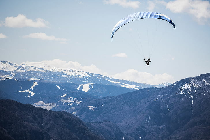 Birds Eye Photography Of Person With Parachute Floating Above Mountains