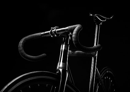 grey scale photography of road bicycle with black background