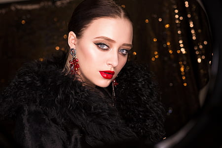 woman wearing black fur accent top