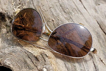 Silver Aviator Sunglasses on Top of Wooden Surface