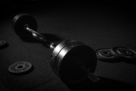 Weight training exercise workout equipment in gym