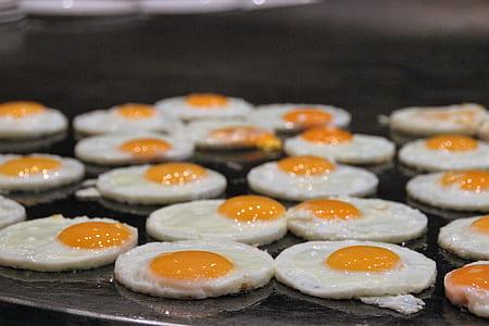 sunny side up eggs on black griddle