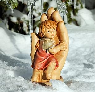 child hugging on hand figurine